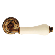 Dalia Door Handles on rose - Aged Brass
